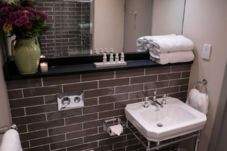 Clean bathroom with wrapped towels