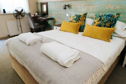 Ready made bed with wrapped towels